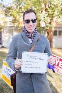Paul Fengler, 39, shows what policies brought him to the polls at Fire Station Number 10 in Arlington, VA.