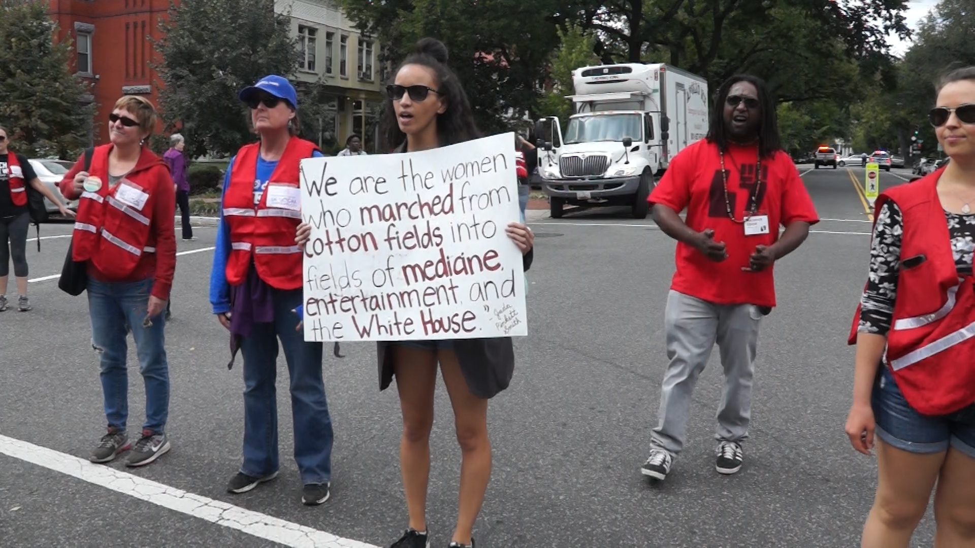 Protestors rally for racial justice and black women's rights